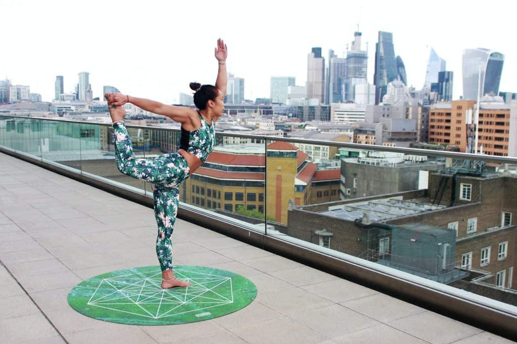 woman doing Pilates on a roof terrace
